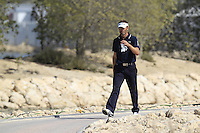 Raphael Jacquelin (FRA) walks to the par3 13th green during Friday's Round 3 of the Commercial Bank Qatar Masters 2013 at Doha Golf Club, Doha, Qatar 25th January 2013 .Photo Eoin Clarke/www.golffile.ie