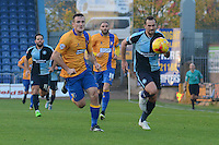 Wycombe Wanderers captain Paul Hayes chases Mansfield Town's Lee Collins for a through ball during the Sky Bet League 2 match between Mansfield Town and Wycombe Wanderers at the One Call Stadium, Mansfield, England on 31 October 2015. Photo by Garry Griffiths.