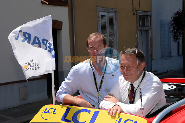 Christian Prudhomme Tour Director with special guest Thierry Braillard Minister for Sport get ready to start Stage 17 of the 2014 Tour de France running 124.5km from Saint-Gaudens to Saint-Lary Pla d'Adet. 23rd July 2014.<br /> Photo ASO/B.Bade/www.newsfile.ie