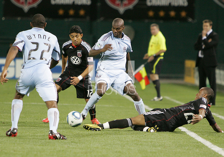 Rodney Wallace #22 of D.C. United pokes the ball away from Omar Cummings #14 of the Colorado Rapids during an MLS match on May 15 2010, at RFK Stadium in Washington D.C. Colorado won 1-0.