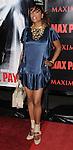 Aisha Tyler arriving at the premiere for Max Payne, held at Mann's  Grauman Chinese Hollywood, Ca. October 13, 2008