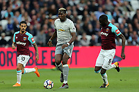 Paul Pogba of Manchester United and Cheikhou Kouyate and Manuel Lanzini of West Ham United during West Ham United vs Manchester United, Premier League Football at The London Stadium on 10th May 2018
