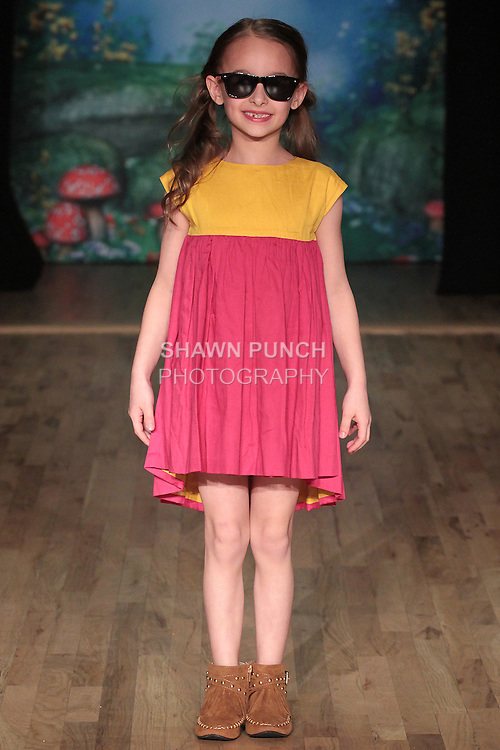 Model walks runway in an outfit from the Marin + Morgan Fall Winter Fall Winter 2016 collection by Saloni Mittal and Radha Nadkarni, at the Posh Magazine, Fashion Carnaval fashion show in WeWork in New York City, on March 19, 2016.