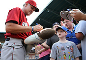 Lehigh Valley IronPigs manager and former Chicago Cubs star Ryne Sandberg signs a doll of himself for Joey Day, of Durham before the Durham Bulls vs. Lehigh Valley baseball game on Thursday, August 4, 2011. Lehigh won 5-3. Photo by Al Drago.