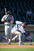 Mesa Solar Sox catcher Willson Contreras (40) makes a play on a blocked pitch as Clint Frazier looks on during an Arizona Fall League game against the Scottsdale Scorpions on October 19, 2015 at Sloan Park in Mesa, Arizona.  Scottsdale defeated Mesa 10-6.  (Mike Janes/Four Seam Images)
