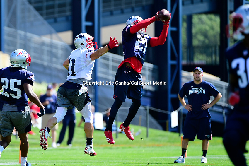 July 28, 2017: New England Patriots cornerback Malcolm Butler (21) intercepts a pass to wide receiver Julian Edelman (11) at the New England Patriots training camp held at Gillette Stadium, in Foxborough, Massachusetts. Eric Canha/CSM