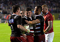 Bryn Gatland is congratulated by teammates after stopping Jonathan Joseph from scoring during the 2017 DHL Lions Series rugby union match between the NZ Provincial Barbarians and British & Irish Lions at Toll Stadium in Whangarei, New Zealand on Saturday, 3 June 2017. Photo: Dave Lintott / lintottphoto.co.nz