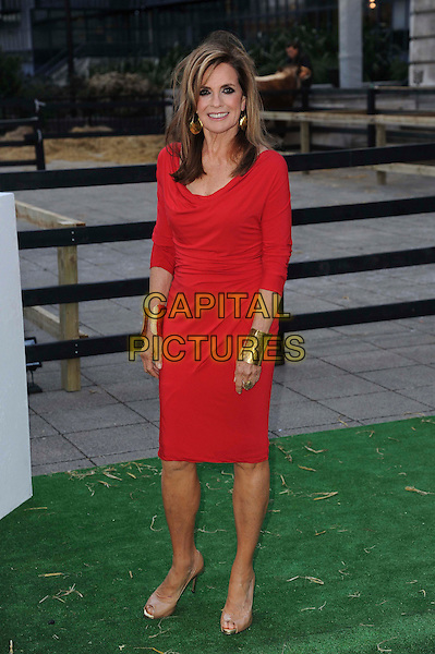 Linda Gray.The Channel 5 Launch Party for the new series of 'Dallas', Old Billingsgate Market, London, England..21st August 2012.full length red dress gold cuffs bracelets .CAP/CAS.©Bob Cass/Capital Pictures.