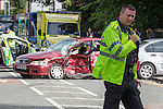 © Joel Goodman - 07973 332324 . 17/08/2013 . Manchester , UK . A sack of cash dumped by the rear wheel of a crashed getaway vehicle . A suspected getaway vehicle (red Honda Accord) crashed in to a silver BMW following a knife-point robbery outside a bank on Northenden Road in Sale , Manchester yesterday afternoon (16th August 2013) . Police have arrested one man but report another is at large . Photo credit : Joel Goodman