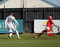 Ryan de Vries (Auckland) beats Scott Basalaj to score the first goal during the Oceania Football Championship final (second leg) football match between Team Wellington and Auckland City FC at David Farrington Park in Wellington, New Zealand on Sunday, 7 May 2017. Photo: Dave Lintott / lintottphoto.co.nz