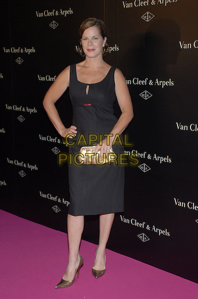 "MARCIA GAY HARDEN.Van Cleef & Arpels Hosts ""Une Journee A Paris"" at the Hammerstein Ballroom, New York, New York, USA..September 4th, 2007.full length black dress gold pointy shoes clutch purse hand on hip .CAP/ADM/BL.©Bill Lyons/AdMedia/Capital Pictures *** Local Caption ***"