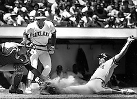 Oakland A's Carney Lansford slides safe at home,<br />