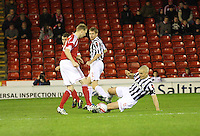 Stephen Hughes (left) and Jim Goodwin challenge for the ball watched by David van Zanten in the Aberdeen v St Mirren Scottish Communities League Cup match played at Pittodrie Stadium, Aberdeen on 30.10.12.