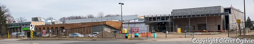 A construction worker on the roof of the main addition, gym and auditorium.