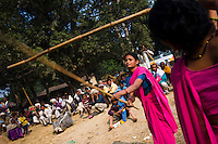 47 year old Sampat Pal Devi (out of picture), founder and leader of the 10,000 strong 'Gulabi Gang' (Pink Gang), trains other women in the group to fight with lathis (traditional Indian sticks). In the badlands of Bundelkhand, one of the poorest parts of one of India's most populous states, a gang of female vigilantes have sprung up to fight the oppression of a caste-ridden, feudalistic and male dominated society. In a land where dowry demands and domestic and sexual violence are common, the 'Gulabi Gang', so called for their uniform of shocking pink saris, are picking up their lathis to fight against corruption and violence against women.
