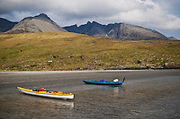 Two Kayaks on beach at Glenbrittle with Black Cuillins in background, Isle of Skye, Scotland
