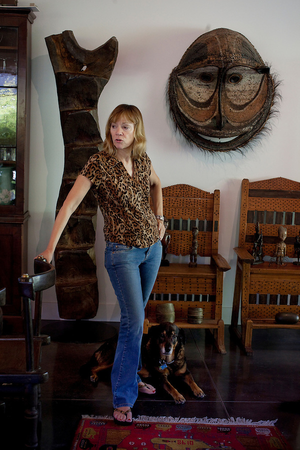 Los Angeles, California, November 14, 2009 - Diane Wolfe along with her dog Malaika  in her Quonset hut inspired home. Diane along with her husband Ernie own the Ernie Wolfe Gallery and are the most reknowned African at dealers in the country. ..CREDIT: Daryl Peveto/LUCEO for The Wall Street Journal.Homefront - Ernie Wolfe #1348.