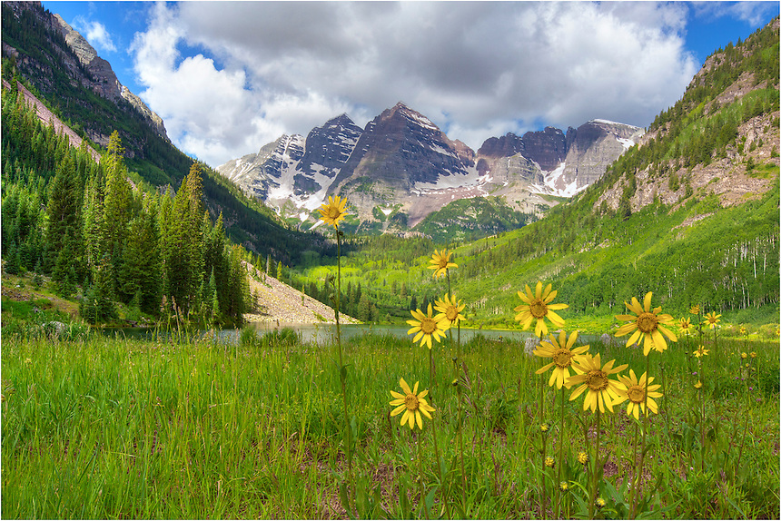 After arriving at the Maroon Bells before sunrise and walking to Crater Lake, I was returning along the trail past Maroon Lake when I noticed these Colorado wildflowers. I had to stop and photograph this landscape with the iconic Maroon Peak and North Maroon Peak in the distance. The morning was calm and the clouds were already starting to build above the peaks, but it was still a beautiful morning.