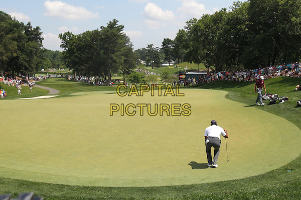 BETHESDA, MD - JUNE 27: Tiger Woods plays on day 2 of the 2014 Quicken Loans National at Congressional Country Club in Bethesda, Maryland on June 27, 2014. <br /> CAP/MPI/mpi34<br /> &copy;mpi34/MediaPunch/Capital Pictures