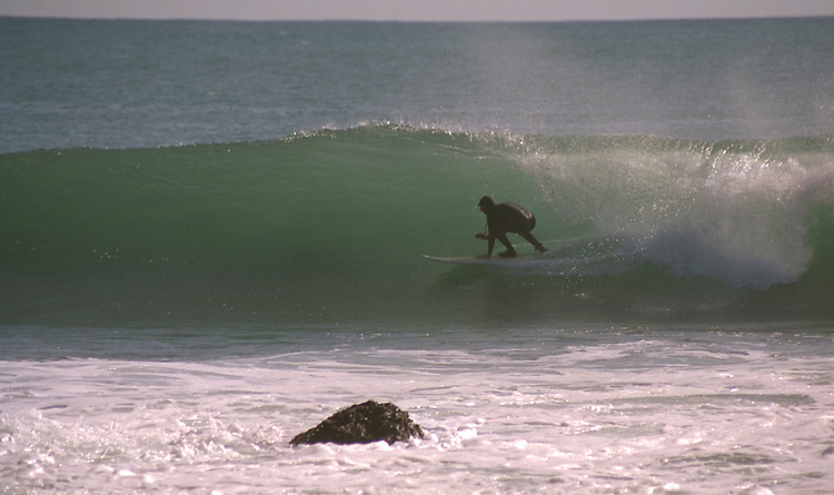 """""""In the tube"""" surfing on the Lost Coast of Northern CA.  CD scan from 35mm flim.. © John Birchard"""