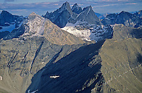 Bush airplane flying amid the Arrigetch Peaks in the Brooks Range at Gates of the Arctic National Park, Alaska, aerial view, TomBean_Pix_0738 .
