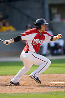 Sean Danielson #8 of the Carolina Mudcats follows through on his swing against the Jacksonville Suns at Five County Stadium May 16, 2010, in Zebulon, North Carolina.  Photo by Brian Westerholt /  Seam Images