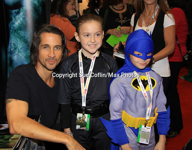 "General Hospital Michael Easton (One Life To Live, Port Charles, Days of Our Lives) with fans at the New York Comic Con 2012 to show fans and others ""Soul Stealer Collector's Edition"" which he cowrote and  was in a booth with Christopher Shy on October 13, 2012 at the Javits Center, New York City, New York. (Photo by Sue Coflin/Max Photos)"