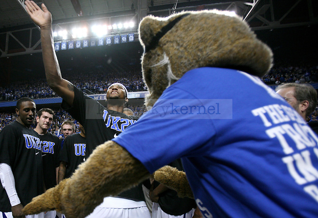 Freshman forward DeMarcus Cousins dances with Wildcat after the UK men's basketball against Drexel at Rupp Arena on Monday, Dec. 21, 2009. The cats celebrated their 2000th win after beating Drexel 88-44. Photo by Adam Wolffbrandt   Staff