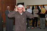 Israel, the Galilee. The Sufi Sheich Abu Falastin conducting the ritual of Zikr- remembrance ? of Allah and the Islamic credos in the Arab town Sachnin, 2004<br />