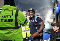 Grimsby Safety Stewards pose for photos with Adebayo Akinfenwa of Wycombe Wanderers as he arrives for the Sky Bet League 2 match between Grimsby Town and Wycombe Wanderers at Blundell Park, Cleethorpes, England on 4 March 2017. Photo by Andy Rowland / PRiME Media Images.