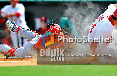 3 March 2011: Washington Nationals' catcher Ivan Rodriguez is unable to get the tag on a sliding Zack Cox during a Spring Training game against the St. Louis Cardinals at Roger Dean Stadium in Jupiter, Florida. The Cardinals defeated the Nationals 7-5 in Grapefruit League action. Mandatory Credit: Ed Wolfstein Photo