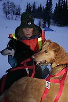 Sally Hamm holds Mike Williams leaders during the early morning at the Finger Lake checkpoint.  Monday, March 7.  2005 Iditarod Sled Dog Race