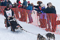 Musher # 56 Aaron Burmeister at the Restart of the 2009 Iditarod in Willow Alaska
