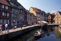 France, canal, Colmar, Alsace, Haut-Rhin, Europe, wine region, Scenic view of tour boats along the canal in the town of Colmar, capital of Haut-Rhin, in the wine region of Alsace.
