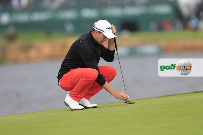 Maximilian KIEFFER (GER) lines up his putt on the 14th green during Saturday's Round 3 of the Portugal Masters 2015 held at the Oceanico Victoria Golf Course, Vilamoura Algarve, Portugal. 15-18th October 2015.<br /> Picture: Eoin Clarke | Golffile<br /> <br /> <br /> <br /> All photos usage must carry mandatory copyright credit (&copy; Golffile | Eoin Clarke)
