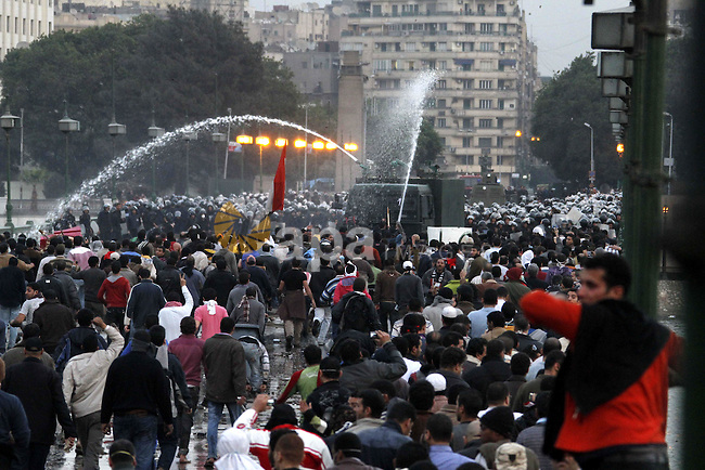 Egyptian policemen fire tear gas canisters towards anti-government protesters during a demonstration against president Hosni Mubarak regime in Tahrir, or Liberation Square in Cairo, Egypt, Jan. 29, 2011. Photo by Karam Nasser