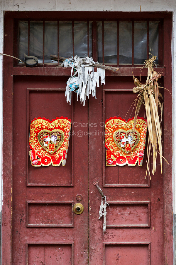 Huanggang, Guizhou, China.  A Dong Ethnic Village.  Door Decorations Celebrating a Recent Wedding, Warding Off Evil Spirits.