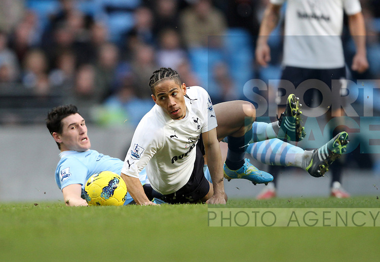 Manchester Citys Gareth Barry tussles with Spurs Steven Pienaar..Manchester City v Tottenham Hotspur in the the Barclays Premier League, at the Etihad Stadium, Manchester. 22nd January 2012.--------------------.Sportimage +44 7980659747.picturedesk@sportimage.co.uk.http://www.sportimage.co.uk/.Editorial use only. Maximum 45 images during a match. No video emulation or promotion as 'live'. No use in games, competitions, merchandise, betting or single club/player services. No use with unofficial audio, video, data, fixtures or club/league logos.