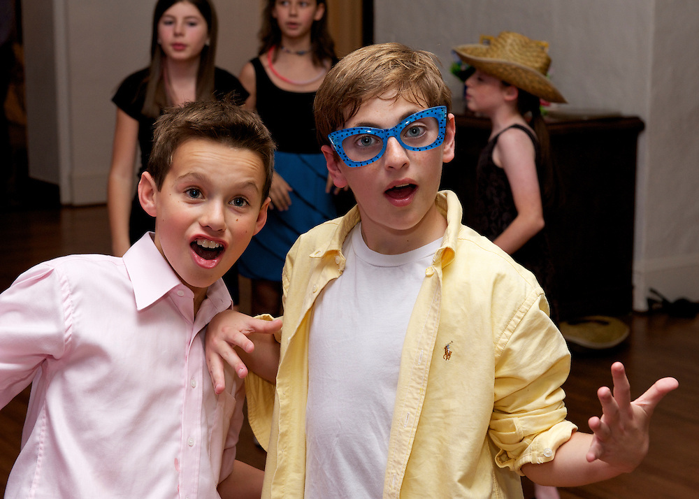 Bar Mitzvah boy dancing wearing novelty glasses.