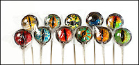 BNPS.co.uk (01202 558833).Pic: RachelAdams/BNPS..Not for the feint hearted.....A house wife has invented a creepy range of eye-popping lollies from a menagerie of cold blooded creatures that might not be to everyone's taste...Priscilla Briggs reptilliain creations are now slithering off the shelves as sweet toothed lollipot lovers from all over the world check out her booming website...Lizard lover Priscilla decided to try her hand at creating the unusual confectionery and mixed sugar with isomalt and corn syrup in a hot pan before pouring it into moulds...Priscilla let the sugary liquid set in two halves, and placed a circular image of a creepy eye over one of the segments...She then placed the two pieces together and waited for them to harden to give the effect of three-dimensional animal eyes...Her first batch of delicious home-made treats received good feedback and as she refined her skills the mother-of-three came up with more unusual ideas and designs...Priscilla, 32, has now produced a batch of 12 brightly coloured,  eyeball themed lollipops that wouldn't look out of place on a chameleon, python, or boa constrictor..