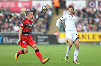 Tom Carroll of Swansea City is marked by Philip Billing of Huddersfield Town during the Premier League match between Swansea City and Huddersfield Town at The Liberty Stadium, Swansea, Wales, UK. Saturday 16 October 2017