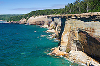 The amazing Pictured Rocks National Lakeshore shoreline on a beautiful summer day. Munising, MI