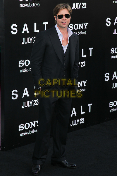 "BRAD PITT.Arrivals to the World Premiere of Sony Pictures' ""Salt"" at Grauman's Chinese Theatre. Los Angeles, CA, USA. .July 19th, 2010.full length black white shirt sunglasses shades gold aviators open chest hands in pockets waistcoat suit .CAP/CEL.©CelPh/Capital Pictures..."