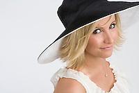 Girl in big black hat