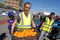 Pireus / Athens 30/3/2016<br /> Refugee camp in Pireus Port. Most of them are women with children coming from Syria.<br /> In the picture food distribution organized by a group of international volunteers.<br /> Photo Livio Senigalliesi
