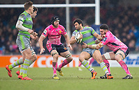 Newcastle Falcons' Maxime Mermoz is tackled by Exeter Cheifs' Dave Dennis<br /> <br /> Photographer Bob Bradford/CameraSport<br /> <br /> Anglo Welsh Cup Semi Final - Exeter Chiefs v Newcastle Falcons - Sunday 11th March 2018 - Sandy Park - Exeter<br /> <br /> World Copyright &copy; 2018 CameraSport. All rights reserved. 43 Linden Ave. Countesthorpe. Leicester. England. LE8 5PG - Tel: +44 (0) 116 277 4147 - admin@camerasport.com - www.camerasport.com