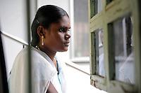 """INDIA Tamil Nadu Dindigul, portraits of young women which have worked in spinning units under the Sumangali scheme, a contract system, in which they are exploited instead of receiving a training and often do not receive the promised salary at the end of the contract / INDIEN Tamil Nadu, Dindigul , Portraets von Frauen die in der Textilindustrie in Spinnereien im Sumangali System gearbeitet haben, Sumangali bedeutet """"glueckliche Braut"""" und ist eine Form von Zwangsarbeit, junge Frauen erhalten einen Vertrag mit Versprechen auf Ausbildung und Zahlung einer Einmalsumme zum Ende der Laufzeit, sie arbeiten oft unter menschenunwuerdigen Bedingungen, werden teilweise sexuell von Vorarbeitern belaestigt und erhalten in vielen Faellen nicht die versprochene Entlohnung, Maedchen Thavamani 20 Jahre"""