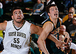NOVEMBER 17, 2014 -- Riley Ryan #32 of Black Hills State battles for rebounding position against Andrew Rebol #55 of South Dakota Mines during their college men's basketball game Monday evening at the Donald E. Young Center in Spearfish, S.D.  (Photo by Dick Carlson/Inertia)