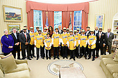 United States President Barack Obama and first lady Michelle Obama meet with the Jackie Robinson West All Stars, the 2014 Little League World Series U.S. champion, in the Oval Office of the White House, November 6, 2014 in Washington, DC.  <br />