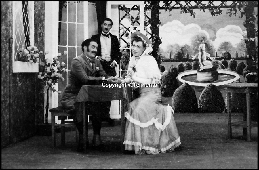 BNPS.co.uk (01202 558833)Pic: Tennants/BNPS<br /> <br /> Bernard Cockcroft playing 'Miss Cecily Cardew' in the play 'The importance of Being Earnest'.<br /> <br /> Oh What a Lovely War...<br /> <br /> The extraordinary level of professionalism a group of British soldiers put into their theatre productions at a PoW camp can be revealed in a newly-discovered archive.<br /> <br /> So serious were the am-dram group of Stalag 383 they created a banked earth floor in a barn to form a sloping auditorium that became known as the 'Ofladium'.<br /> <br /> The men bartered their Red Cross parcels with their German guards for materials and props and then spent weeks creating sets that wouldn't look out of place in a West End theatre.<br /> <br /> The sets, costumes, performances and concert programmes were of almost professional standards, with a great deal of time, effort and skill clearly going into creating them.